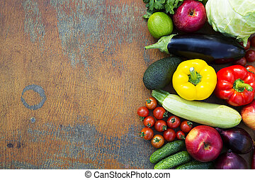 Composition of fruits and vegetables on rustic wooden background. Copy space. Healthy food. Top view. From above.