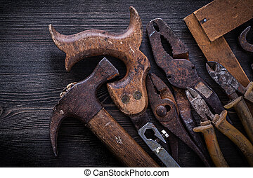 Composition of hacksaw nippers pliers tin snips hammer square ruler.