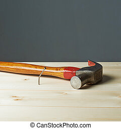 Composition of hammer and nail - Composition of the hammer...