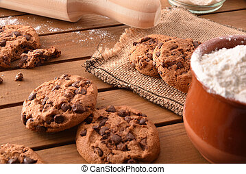 Composition of handmade chocolate cookies on wooden slatted table elevated