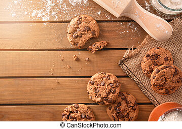Composition of handmade chocolate cookies on wooden slatted table top