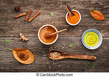 Composition of nature spa ingredients on the dark wooden...