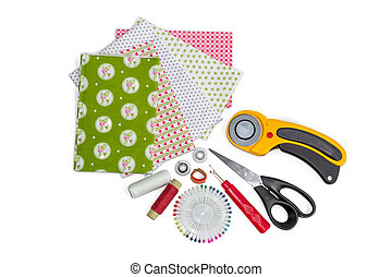 Composition of patchwork quilting instruments, items and fabrics