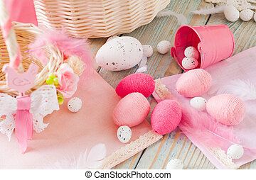 Composition of pink textile eggs on napkin