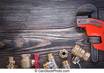 Composition of plumbers equipment on wooden board plumbing conce