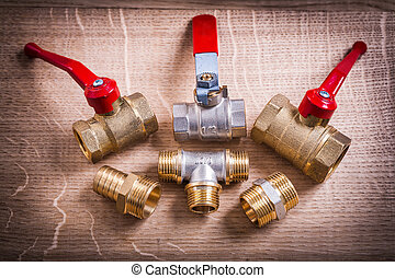 Composition Of Plumbing Tools Brass Pipe Connectors On Wooden Bo