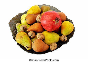 pomegranates, apples, pears and nuts in a vase on white background