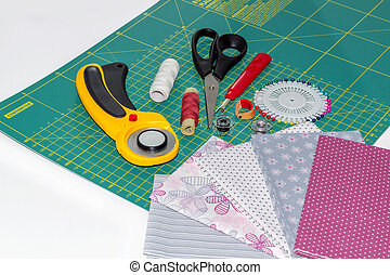 Composition of quilting instruments, objects and fabrics