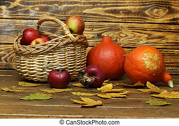 Composition of ripe red apples on a blurred background