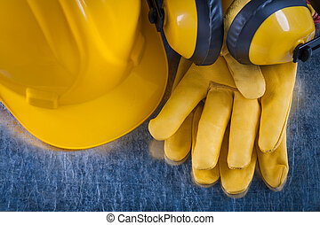 Composition of safety workwear on scratched metallic background