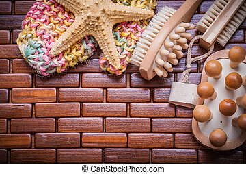 Composition of sauna accessories on checked wooden place mat clo