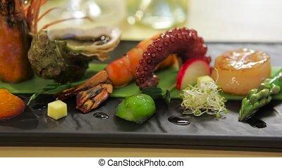 Composition of seafood and fresh vegetables, horizontal pan, closeup