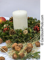 Composition of the Christmas decorations on white tablecloth