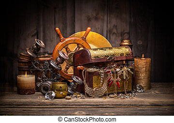 Composition of treasure chest on wooden background