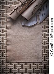 Composition of vintage blank sheet corded paper rolls feather