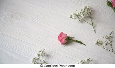 Composition of white and pink flowers rustic style, for St. Valentine's Day with a place for your text. Flat lay, top view