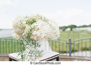 Composition of white hydrangeas in the wedding decor of the exit ceremony