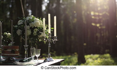 Composition of white vintage candelabrum and white roses...