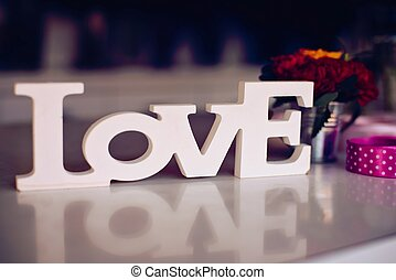 Composition of wooden Love word