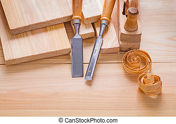 composition of woodworking tools carpentry chisels and plane on wooden boards