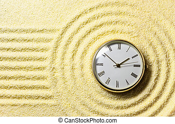 Composition on Zen garden - sand, and watch