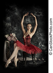 composition - Beautiful bellet dancer posing at studio over...