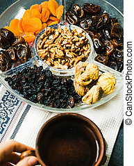 Composition with assorted dried fruits and nuts. Healthy dessert.