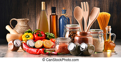 Composition with assorted food products and kitchen utensils...