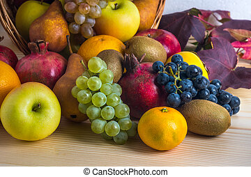 Composition with assorted fruits in wicker basket, healthy life