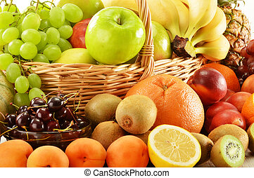 Composition with assorted fruits in wicker basket