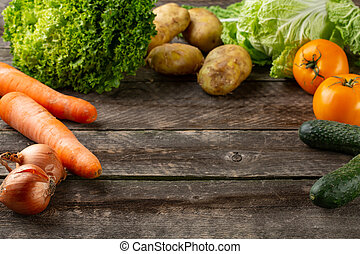 Composition with assorted raw organic vegetables on broun...