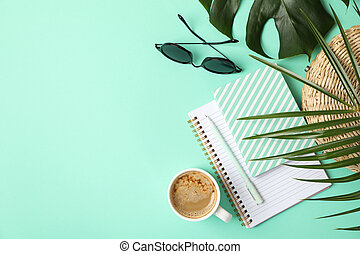 Composition with blogger accessories on mint background. Travel blog