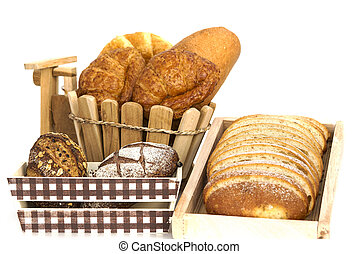 Composition with bread and rolls in wicker basket isolated on white backgound