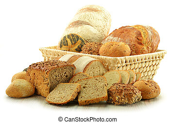 Composition with bread and rolls in wicker basket isolated...