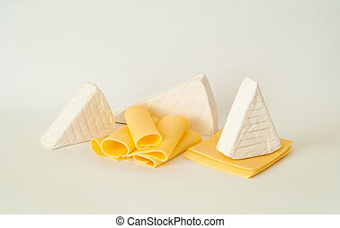 Composition with cheeses on isolated white background. Copy space, closeup.