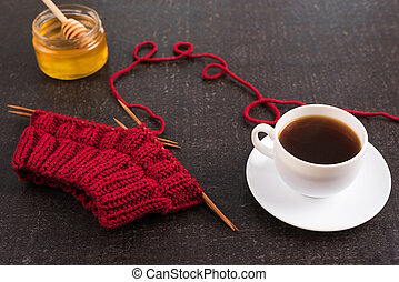 Composition with coffee, honey and knitting