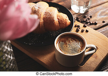 Composition with delicious croissant on wooden background, close up