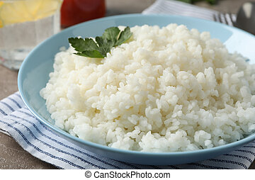Composition with delicious rice on grey background, close up