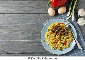 Composition with delicious rice on wooden background, top view