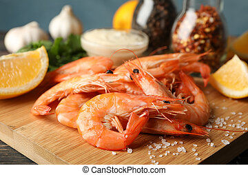 Composition with delicious shrimps on wooden background, close up