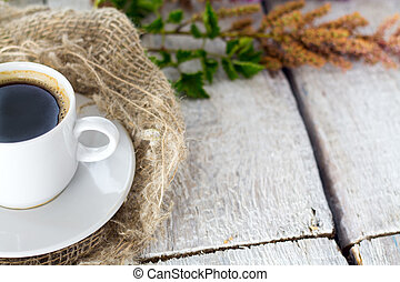 Composition with flowers and a coffee cup on white background..