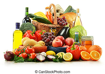 Composition with groceries and basket isolated on white....