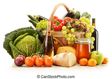 Composition with grocery products in wicker basket isolated