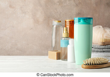 Composition with hair care products on wooden table. Blank space for label