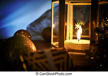 Composition with lantern and christmas decoration in the dark