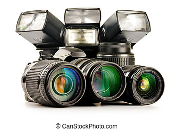 Composition with photo equipment including zoom lenses, camera and flash lights isolated on white