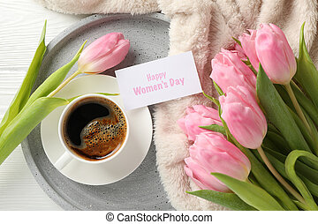 Composition with pink tulips on white wooden background, top view