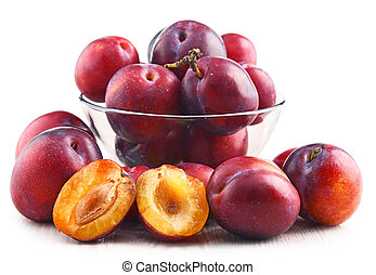 Composition with plums isolated on white background