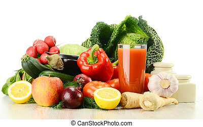 Composition with raw vegetables and glass of juice isolated on w