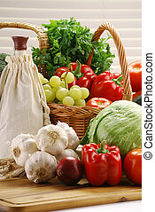 Composition with raw vegetables and wicker basket